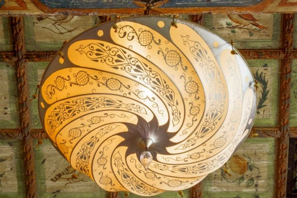 Silk Fortuny lamp on a painted coffered ceiling.