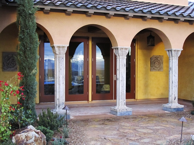 Back patio with stone reliefs in the wall and carved stone venetian style columns