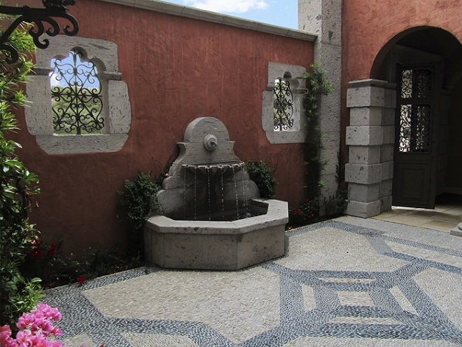 Fountain, windows, floorings and wrought iron designs.